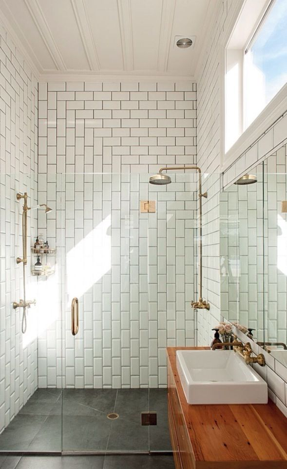 Tiled shower with glass door bathroom