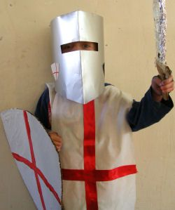 Easy Knight's tabard and shield for dramatic play.  Also other cute tabard ideas using iron-on transfers.