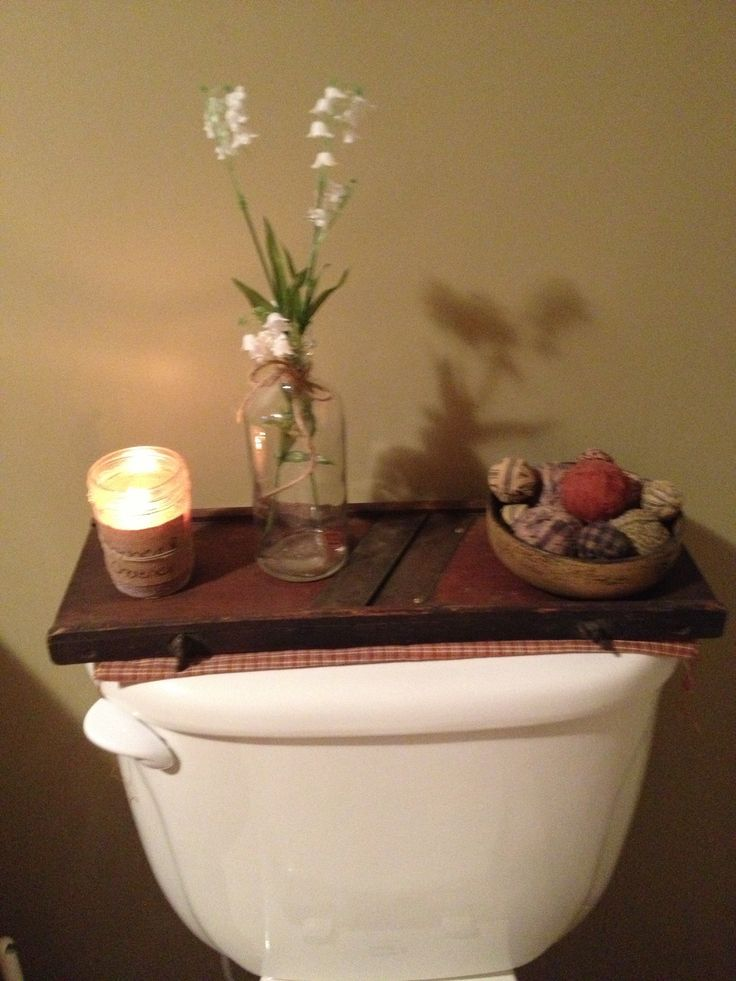 Toilet tank decoration ideas toilet tank cover for Toilet decor