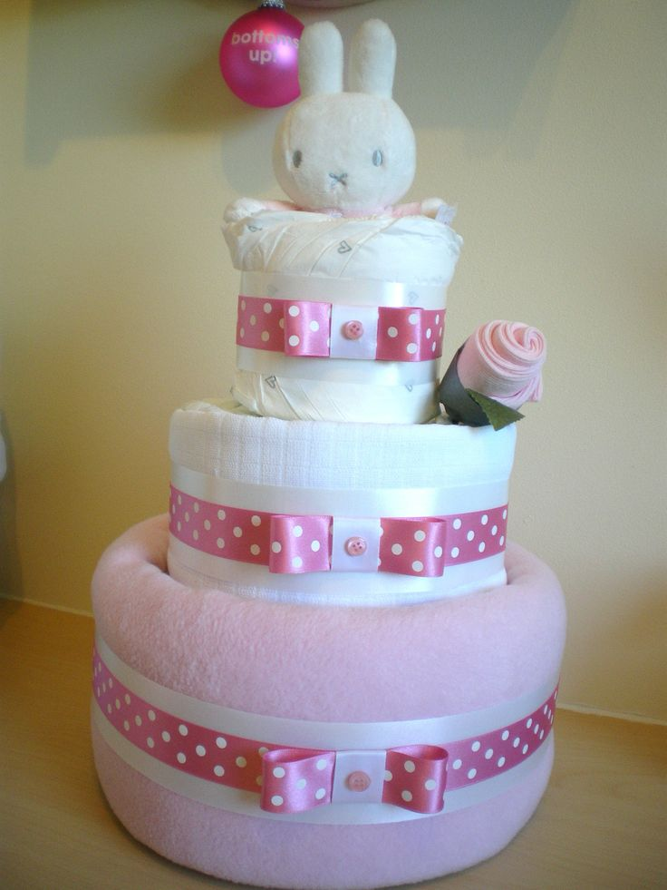 Pink 3 tier nappy cake with Miffy topper and sock rosebud.