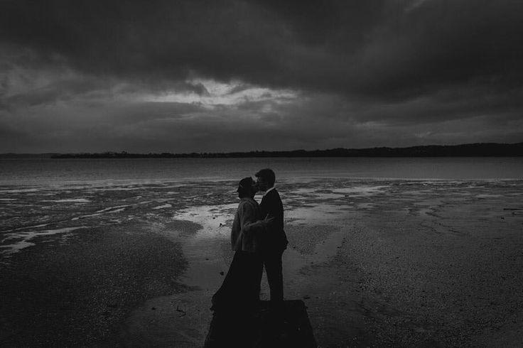 Moody winter wedding in Auckland New Zealand  #blackclouds #wedding #aucklandwedding #blackandwhite #silhouette