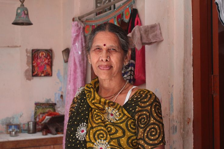 This woman's home and personal aesthetic was wonderfully inspiring. The contrast between the bold green and yellow spiral print and the delicate floral beading is interesting and compliments the pink ethnic background.