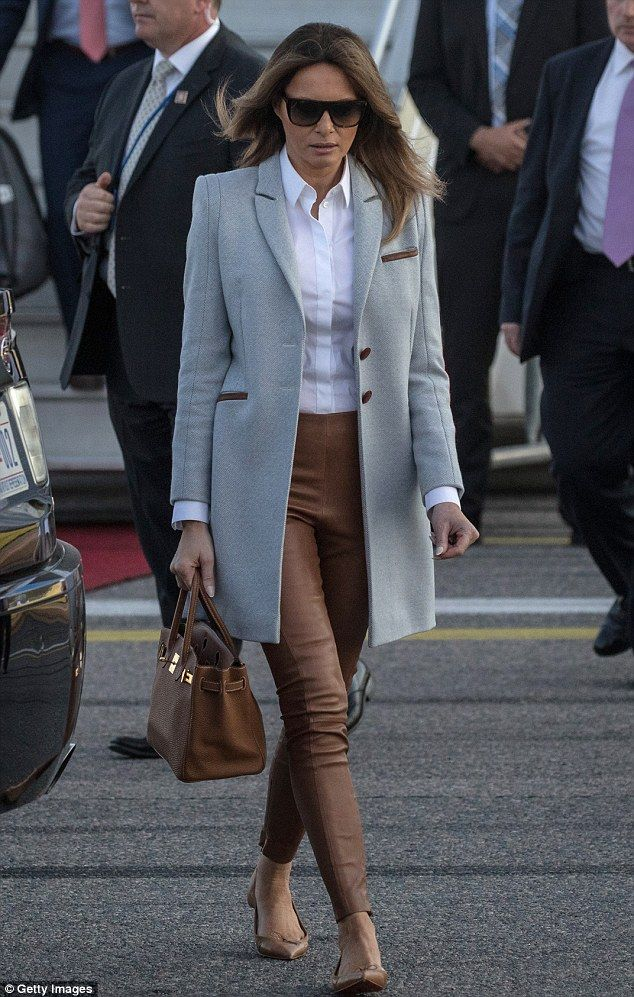 83d4af18eb1 Comfortable  It is not often the first lady opts for flat shoes instead of  heels. She paired the look with matching brown pants