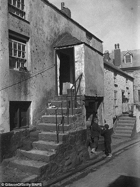 The photographs depict modest fishermen's cottages that provided basic accommodation to po...