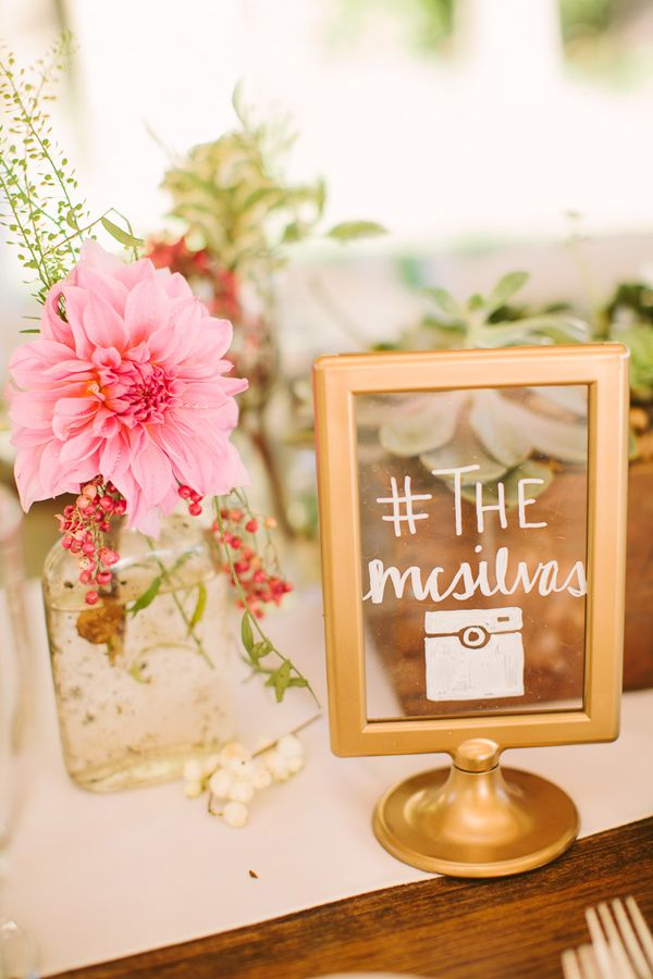 spray paint Ikea frames gold and use them as signage - photo by http://www.rebecca-arthurs.com/ - http://ruffledblog.com/rhode-island-beach-wedding/