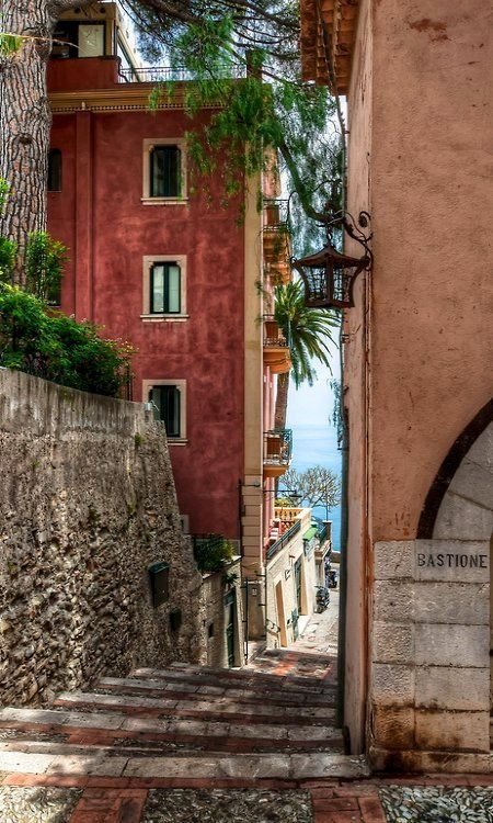 Sicily's legendary resort town of Taormina ~ has twisting medieval streets and the Ionian Sea in the background