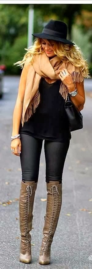 long boots with hat black blouse scarf and had bag