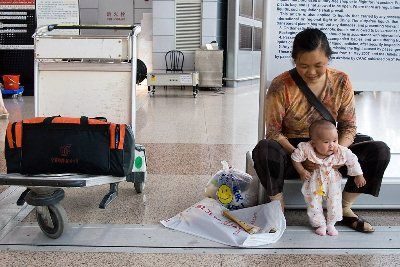 Baby Ying and her nanny returning to their home province after sugery.