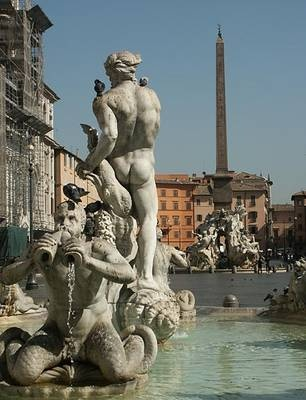 The Piazza Navona square was built exactly on the area of emperor Domitian's stadium (81-96 AD), and retains the stadium's oblong shape with a rounded north end. It was the largest in ancient Rome, larger than the Coliseum, and it could seat 50,000 spectators.