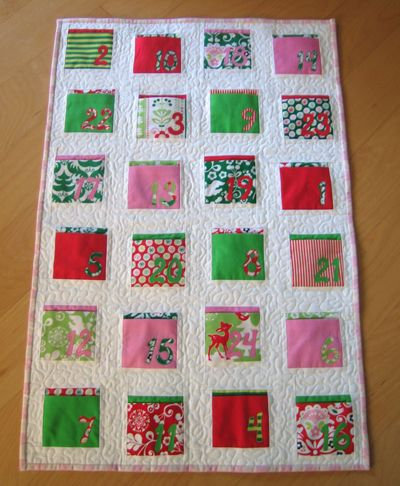 need to make this quilted advent calendar.  maybe with my cherry christmas layer cake?