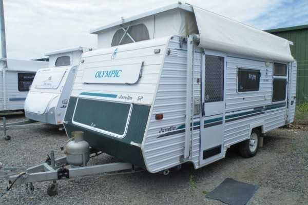 Olympic Javelin SP pop-top caravan manufactured November 2005, approx 17ft - Mass: 1280kg, GTM: 1500kg, ATM: 1630 giving a calculated ball weight of 130kg, single axle.......Roll-out awning......caravan cover.....full set of towing aids......mirrors....sullage and water hoses....TV antenna....shade cloth side for awning....free standing gazebo.... front kitchen with 4 burner gas cook-top....grill....range-hood...3 way fridge..R/C Heron air conditioning..central dine area with lounge…