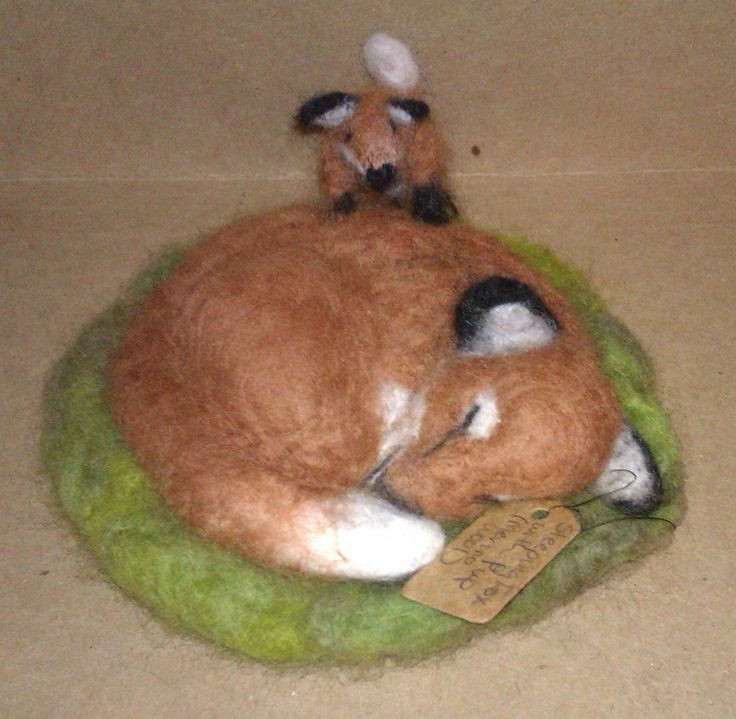 """""""Sleeping Fox with Kit""""; 2014; needle felted sculpture by Holly Boone of Polar Lights Art Studio. Currently located at the Alberta Craft Council. - SOLD! http://polarlightsart.wix.com/plas#!hollys-work/cq0w"""