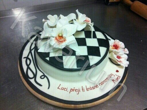 Black cake with orchids