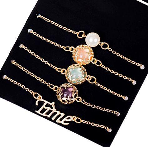 https://www.goedkopesieraden.net/5-gouden-armbanden-met-gekleurde-stenen