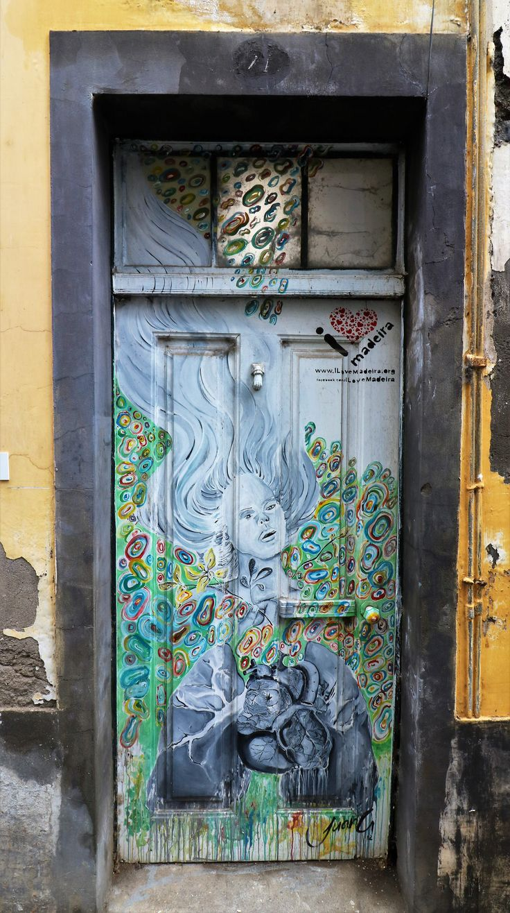 Art work by local artists on the doors down Rua Santa Maria, Funchal