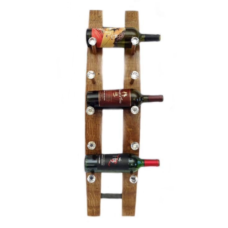 Hand-crafted wine rack made from the staves of retired and repurposed French white oak barrels. Crystal knobs are added to make this a beautiful and unique wine rack that will provide a special and on