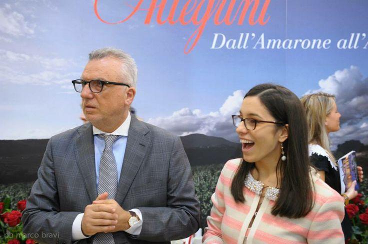 Proud father Giancarlo Mastella with daughter Caterina Mastella Allegrini at the Allegrini pavilion during #vinitaly2014
