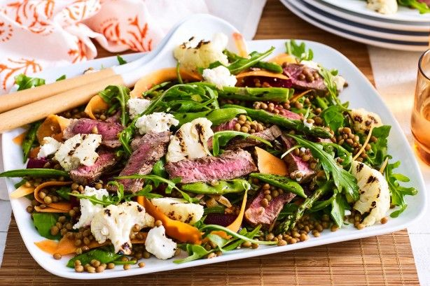 Spring into the new season with this charred pea, asparagus, cauliflower and lamb salad.