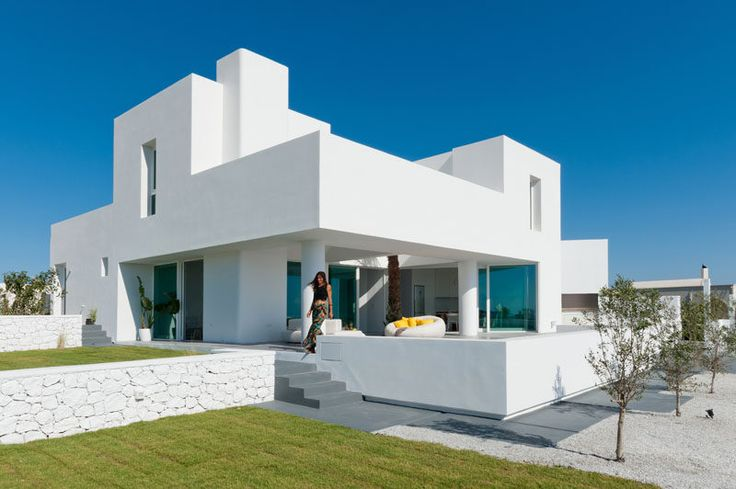 This House With Sea Views Sits On A Sloped Site On The Island Of Santorini