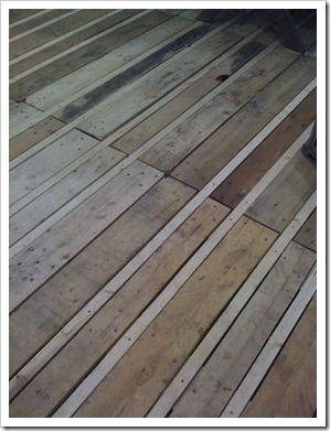 Pallet deck, beautiful, unique and budget friendly. Website is not in english but picture gives good ideas
