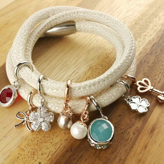 Endless leather bracelet one loop price at 10usd only and variety of charm cubic,pearl,birthstone staring at 1.5usd only...create your cool wrap bracelet at your choice.
