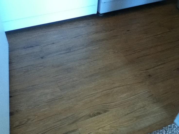 New vinyl plank on laundry room floor