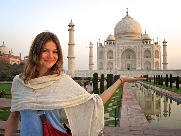 Beautiful Girl enjoying at Tajmahal to see the lovely historical palce