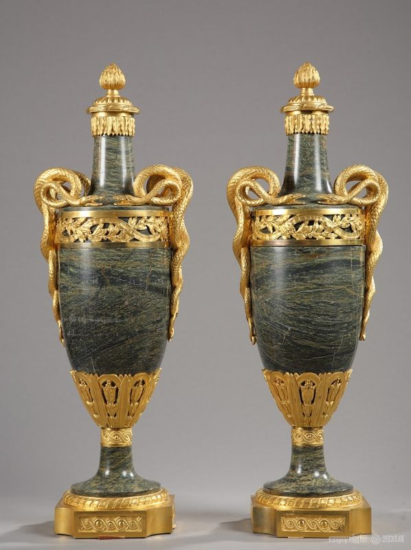 A late XIXth century pair of green marble and gilt bronze vases