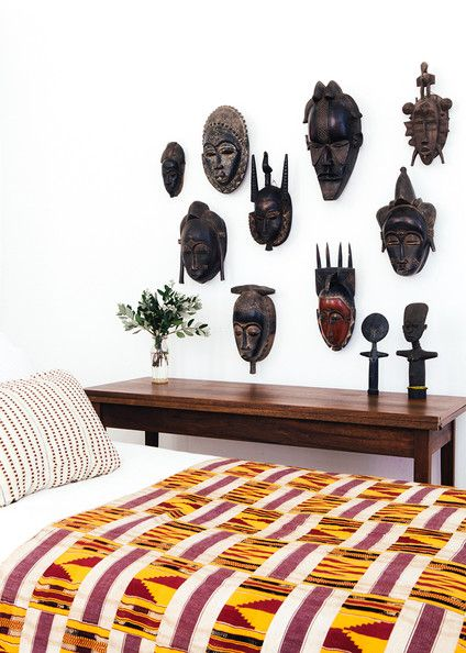Collection of African masks on a bedroom wall. Made by Master Carver Nana Frimpong Boady, who serves as chief carver to the Ashanti King.