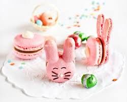 Now here we are with a macaroon that is a bunny. The steps are simply simple one make a macaroon two make the ears three get black frosting and a little white nose four decorate away! Paris