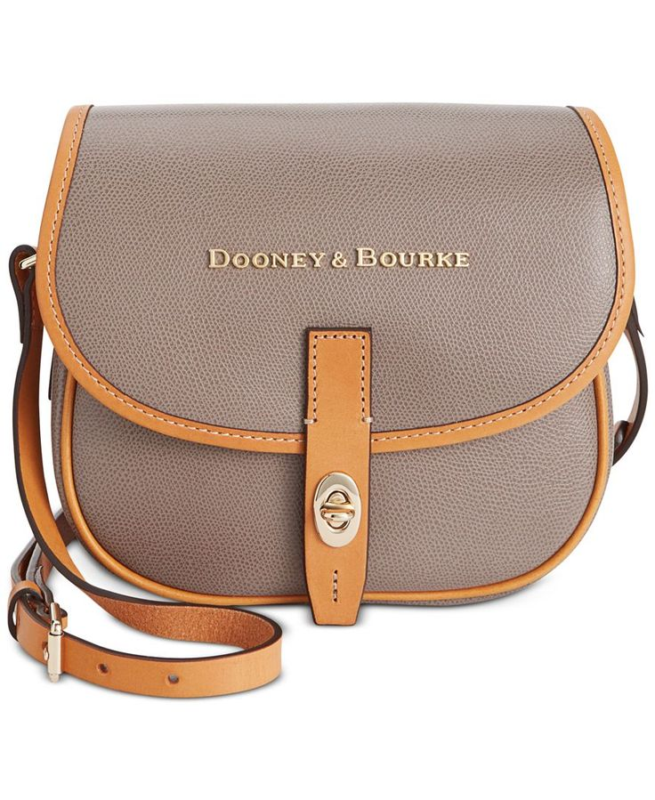 Rich leather and bold new lettering enliven Dooney & Bourke's Claremont Field Bag with irresistible appeal. Inside, a bright pop of color highlights its many organizational features, including a numbe