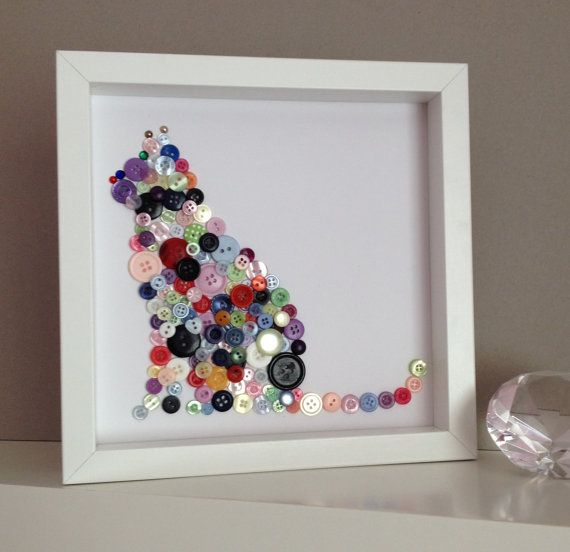 A lovely piece of wall art for all you cat lovers out there.  Made with different size, shape and coloured buttons that are overlapped and layered for a 3D effect.  Art work comes in a 25cm x 25cm white box frame with glass. The frame is ready to hang or can be left free standing. I will pack this lovely piece of art with much care (and plenty of bubble wrap!) so it arrives in the perfect condition you expect.  If you have any questions please dont hesitate in contacting me.