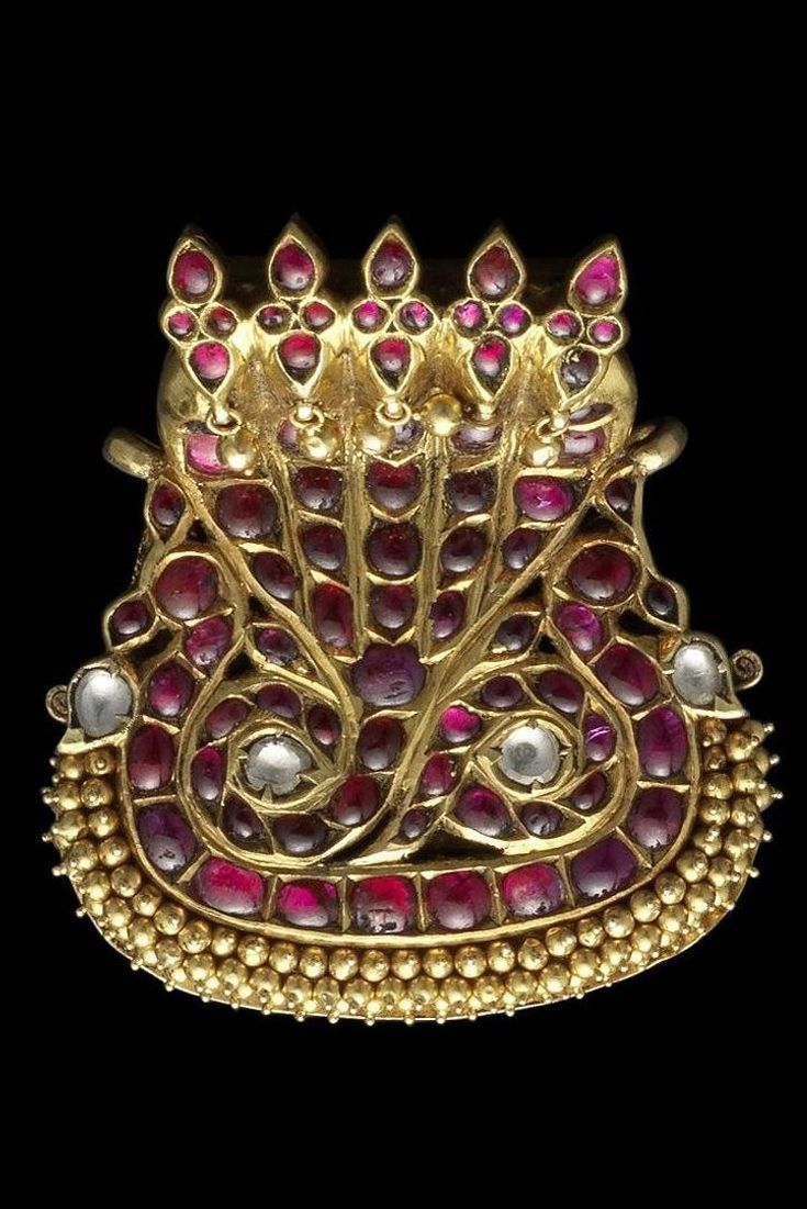 South India | Diamond and ruby set gold hair ornament; in the form of addorsed peacocks with projecting tails | 19th century | 5'000£ ~ sold (Oct '11)