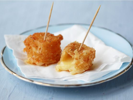 Honey Glazed Fried Manchego Cheese - http://www.food.com/recipe/honey-glazed-fried-manchego-cheese-449980