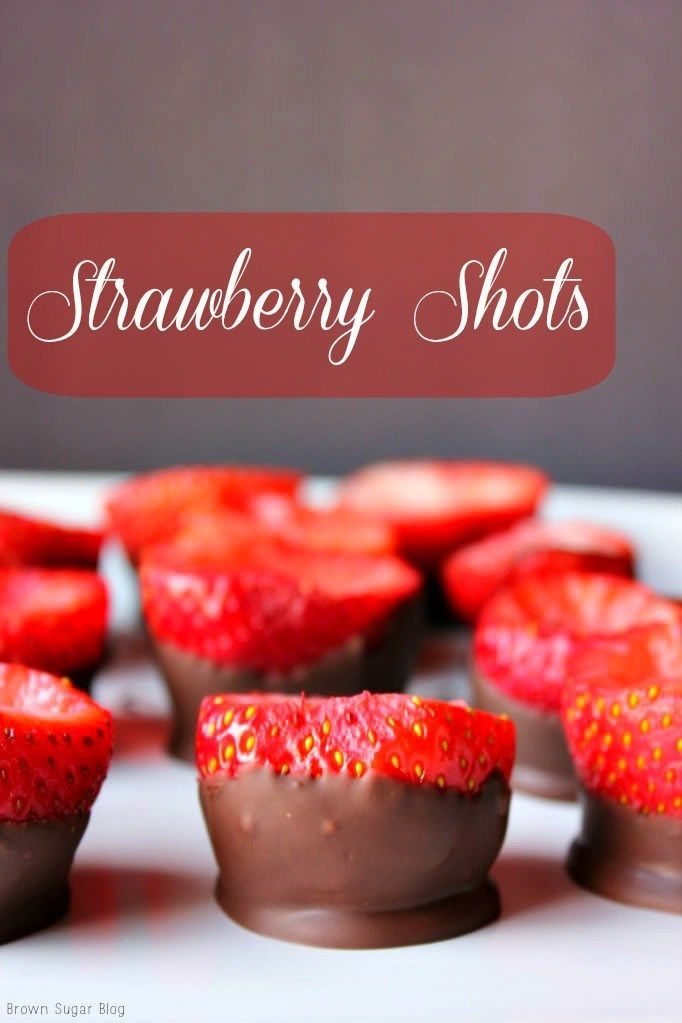 Strawberry Shots- Use fresh strawberries as a tasty shot glass for vodka shots! Just coat the bottom with chocolate so they can stand sturdy! #cocktails #valentinesday #shotglass