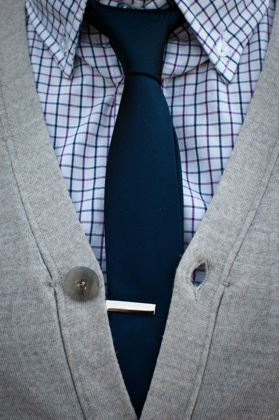 The versatile grey cardigan, paired with tie and tie bar.
