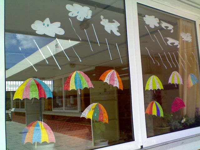 Window decoration with umbrellas made by kids