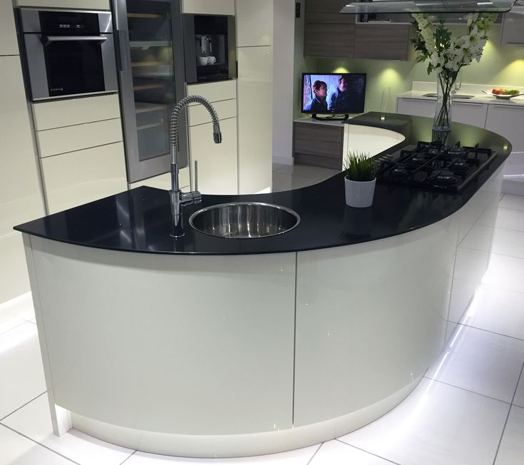 Gloss Ivory Kitchen Island With Large Curved Units And Black Glass Worktop.  For More Gloss