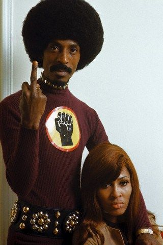 Ike and Tina Turner flipping the bird. Middle finger.