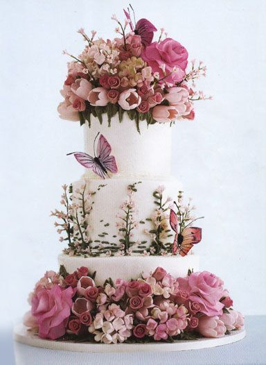 My eyes are popping out of my heart in the shape of love hearts right now. Oh. My. Word. This is perfection in a wedding cake! Wonderful floristry and design!