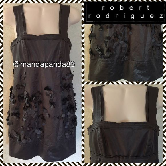 Sexy Gray Metallic Cocktail Dress EUC This dress is amazing! It is a gunmetal gray metallic color with ribbon style straps and torso accents. What makes it so unique is the circle clusters sewn on and stand out! It has a banded bottom. This dress is no longer made! Thank you!  Robert Rodriguez Dresses Midi