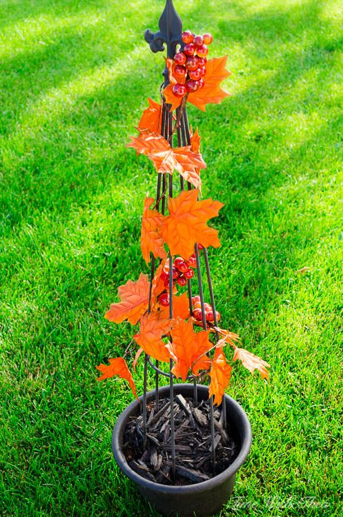 Make Faux Fall Planters Using Decorated Obelisks ~ Wrap a faux leaf garland inside and outside a black urn obeilisk / timewiththea.com