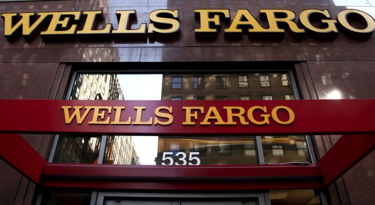 Big pay cuts for top Wells Fargo execs as the fallout continues from the phony account scandal.