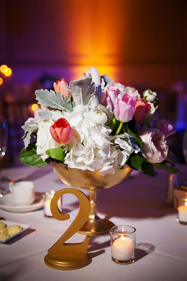Wedding Reception Table Decor with Gold Table Numbers and Pink, Red, and White Floral Centerpieces with Succulents | Limelight Photography on @marrymetampabay via @aislesociety