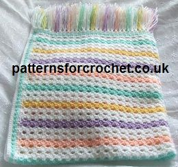 Multi coloured free crochet baby blanket pattern from http://www.patternsforcrochet.co.uk/afghan-blanket-usa.html #crochet #freebabyblanketpatterns