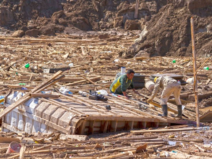 People look into the rubble at an area that was flooded in Chanaral, northern Chile, after heavy rainfall caused the overflowing of the Copiapo river.  Patricio Miranda, AFP/Getty Images