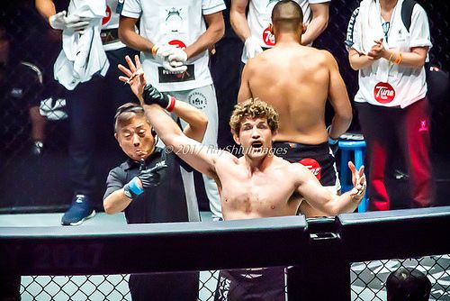 https://flic.kr/p/UZbmbf | Ben Askren | Ben Askren of the USA with ref holding up his arm in victory at the ONE Championship event, Dynasty of Heros in Singapore.