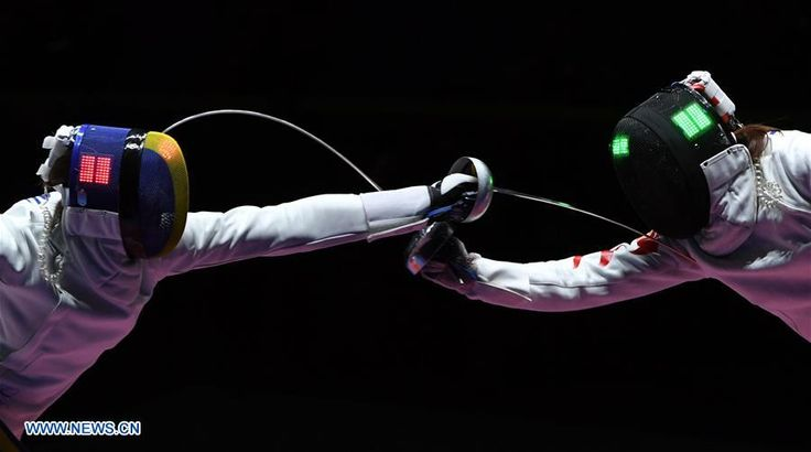 China's Xu Anqi competes against Romania's Ana Maria Popescu during women's epee team gold medal match of fencing at the 2016 Rio Olympic Games in Rio de Janeiro, Brazil, on Aug. 11, 2016. Romania won the gold medal.  http://www.chinasportsbeat.com/2016/08/defending-chinas-womens-epee-team.html