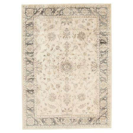 Adding a traditional touch to any scheme, this artfully faded rug features a floral design in an ivory tone.  Product: Rug ...