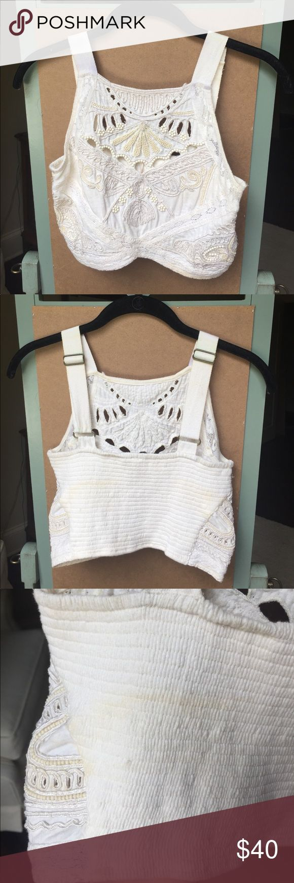 Free people beaded crop top Free people hand-beaded crop top! A really unique top! Wore it to a music festival once, so it has some staining on it (see in photos). Free People Tops Crop Tops